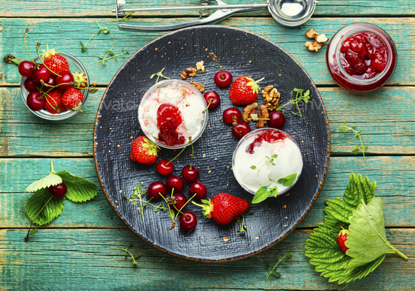 Tasty ice cream with berries and jam - Stock Photo - Images