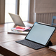 Mockup Digital tablet blank screen and office equipment on wooden table. - PhotoDune Item for Sale