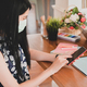 Woman wearing a medical mask is using a smartphone with a tablet. - PhotoDune Item for Sale