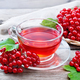 Tea from viburnum in cup on old wooden board - PhotoDune Item for Sale