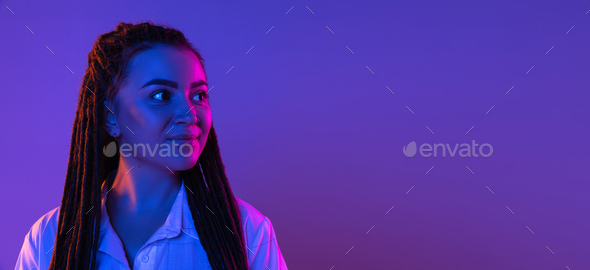 Young woman's portrait on gradient colors studio background in neon. Concept of human emotions - Stock Photo - Images