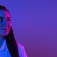 Young woman's portrait on gradient colors studio background in neon. Concept of human emotions - PhotoDune Item for Sale