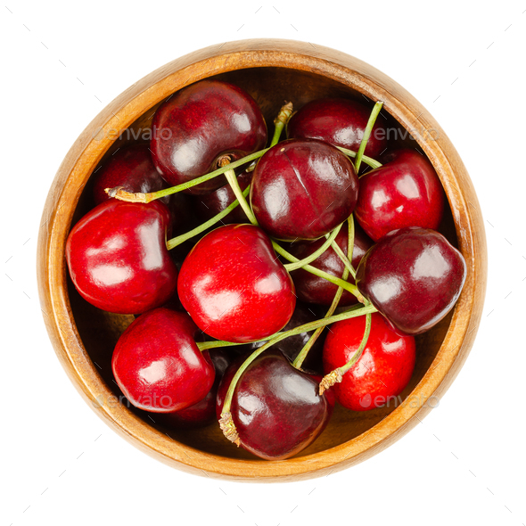 Fresh cherries, in a wooden bowl, red and ripe fruits, ready to eat - Stock Photo - Images