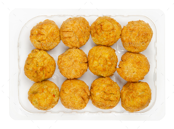 Pre-fried vegan falafel balls, in a clear plastic container - Stock Photo - Images