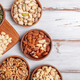 Different kind of nuts in wooden bowls - PhotoDune Item for Sale