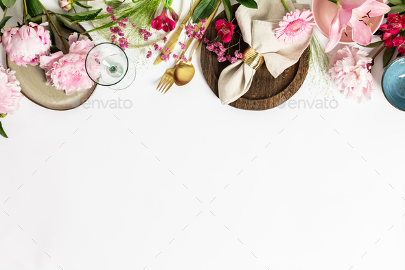 Spring table setting concept - beautiful pink flowers, trendy crockery and cutlery - Stock Photo - Images
