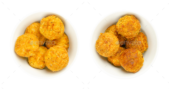 Vegan falafel balls, pre- and deep-fried chickpea fritters, in white bowls - Stock Photo - Images