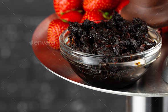 Hookah with strawberry flavour close up on dark background - Stock Photo - Images