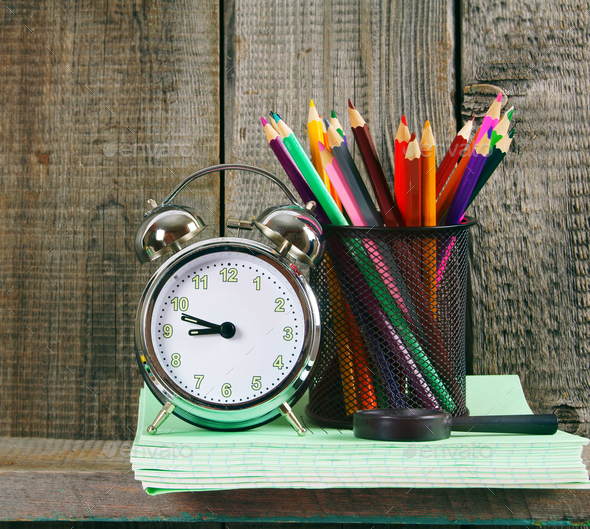 Alarm clock and school accessories . - Stock Photo - Images
