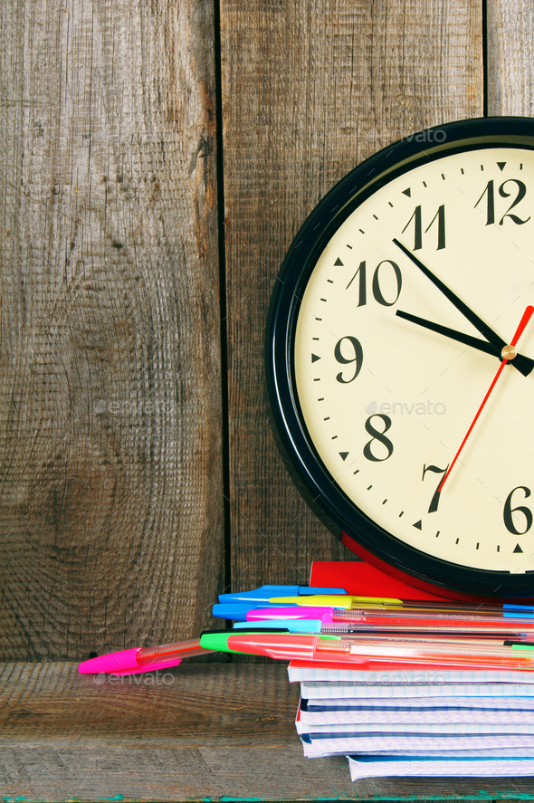 Watches and school tools. On wooden background. - Stock Photo - Images
