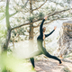 Young woman doing yoga in forest at the forest. - PhotoDune Item for Sale