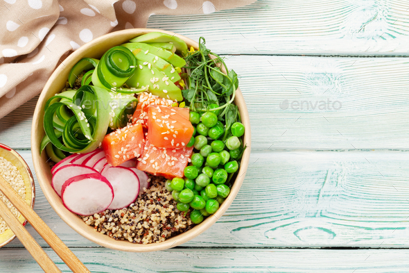 Poke bowl with salmon, cucumber and avocado - Stock Photo - Images