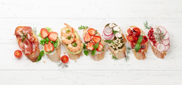 Appetizers plate with traditional spanish tapas set. Italian antipasti brushetta snacks - Stock Photo - Images
