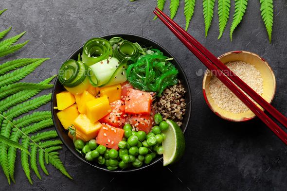 Poke bowl with salmon, cucumber and mango - Stock Photo - Images