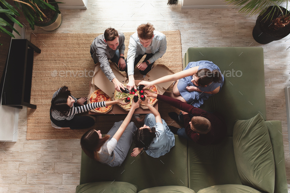Pizza party, group of friends chatting, eating pizza, drinking sweet soda water - Stock Photo - Images