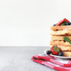 Stack of waffles on plate on towel with blueberry, strawberry, mint leaves - PhotoDune Item for Sale