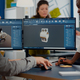 Diverse team discussing about industrial project using dual monitors - PhotoDune Item for Sale