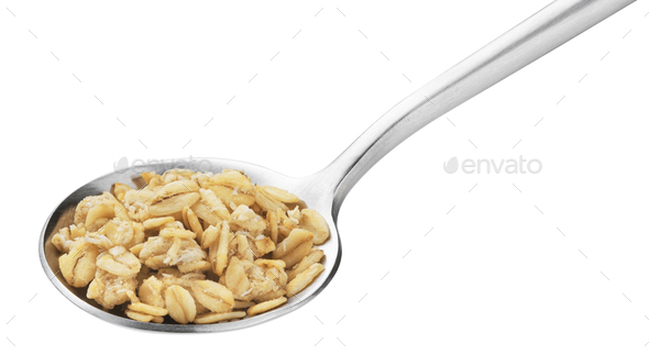 Granola, crunchy muesli in spoon isolated on white background - Stock Photo - Images