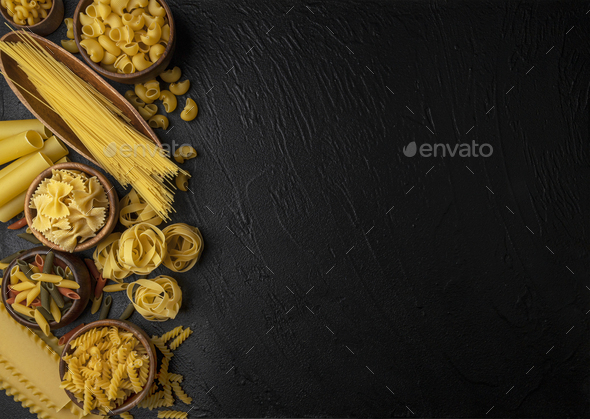 Different pasta types on blue background, top view - Stock Photo - Images