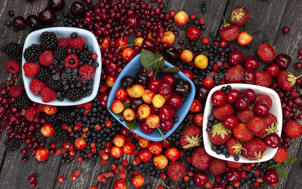 Fresh wild berries on wooden background, top view - Stock Photo - Images