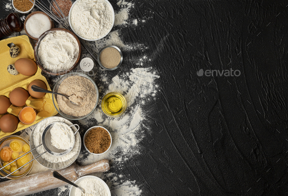 Baking ingredients for dough on black background - Stock Photo - Images