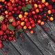 Fresh wild berries on wooden background, top view - PhotoDune Item for Sale