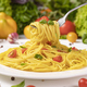 Italian pasta on fork with tomatoes and basil leaves - PhotoDune Item for Sale