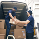 Bottom view of couriers unloading packages during a pandemic - PhotoDune Item for Sale