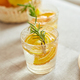 Citrus and rosemary fresh lemonade in glass on a white table at home - PhotoDune Item for Sale