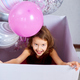 Cute, joyful little girl in pink dress looks out of the big present gift box with balloons - PhotoDune Item for Sale