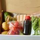 Woman hold in hand food box meal kit of fresh ingredients order from a meal kit company - PhotoDune Item for Sale