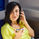 Cheerful woman in casual clothes with headphones and smartphone, record to podcast - PhotoDune Item for Sale