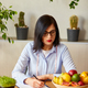 Nutritionist, dietitian woman writing a diet plan, with healthy vegetables and fruits - PhotoDune Item for Sale