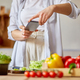 Woman taking photo of healthy salad with smartphone for her blog on kitchen at home - PhotoDune Item for Sale