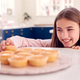 Teenage Girl Taking Freshly Baked Homemade Cupcake From Plate In Kitchen At Home - PhotoDune Item for Sale