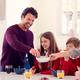 Parents Having Breakfast With Children In School Uniform At Kitchen Counter - PhotoDune Item for Sale