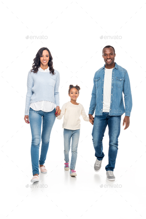 happy african american family holding hands and walking together isolated on white - Stock Photo - Images