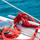 Sailing boat mooring rope tied on cleat. Heavy metal chain around the winch - PhotoDune Item for Sale