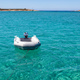 Dinghy Inflatable boat on turquoise blue sea water - PhotoDune Item for Sale