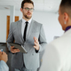 photo of young businessman explaining presentation to his colleagues before the public presentation. - PhotoDune Item for Sale