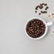 Cup of coffee switching on grey background. Top view, flat lay - PhotoDune Item for Sale