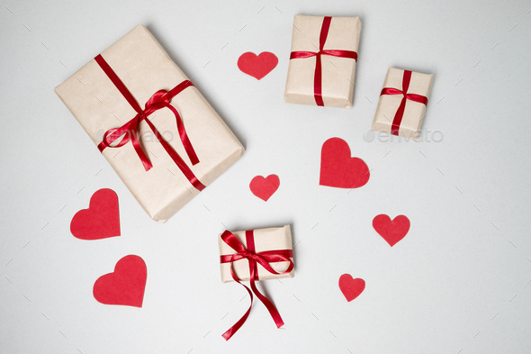 Preparation for Valentine day with gift boxes, red ribbon and hearts on white background - Stock Photo - Images