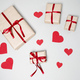 Preparation for Valentine day with gift boxes, red ribbon and hearts on white background - PhotoDune Item for Sale