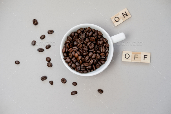 Cup of coffee switching on grey background. Top view, flat lay - Stock Photo - Images