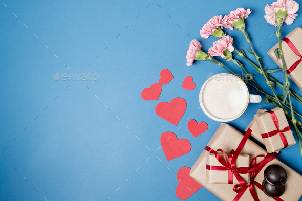 Morning breakfast for Valentines day. Coffee, chocolate candies, gift boxes, paper heart - Stock Photo - Images