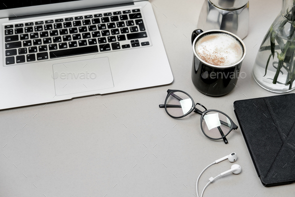 Work space table with laptop, phone and coffee on grey background. Top view, Flat lay - Stock Photo - Images