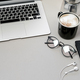 Work space table with laptop, phone and coffee on grey background. Top view, Flat lay - PhotoDune Item for Sale