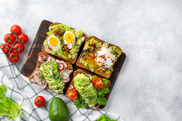 Assortment of vegan sandwiches with avocado and tomatoes - Stock Photo - Images
