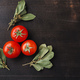 Tomatoes and bunches of dried bay leaves on dark wooden table - PhotoDune Item for Sale