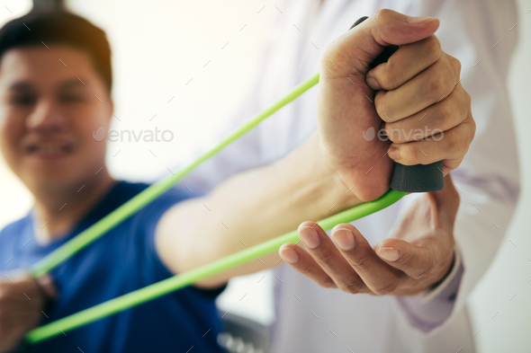 hand patient doing stretching exercise with a flexible exercise - Stock Photo - Images